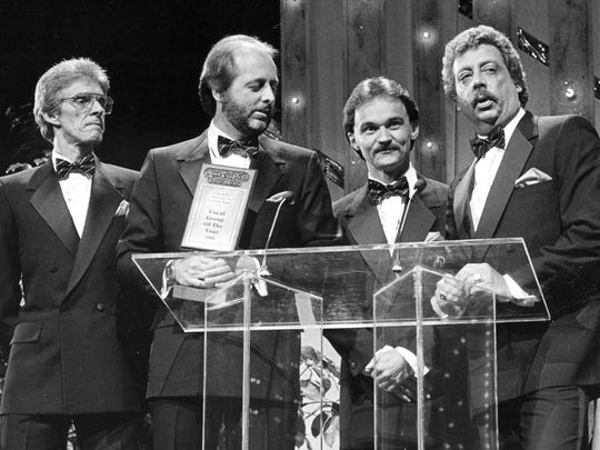 """The Statler Brothers — Phil Balsley, Don Reid, Jimmy Fortune and Harold Reid at the time (shown from left) — accept one of their six awards during the annual TNN/Music City News Country Awards show at the Grand Ole Opry House in Nashville in 1985. On Sunday in print and online, veteran News Leader reporter Brad Zinn and photographer Griffin Moores look at the Statler legacy, and catch up with the Reid brothers. """"Some days, I sit on my beautiful front porch, here in Staunton, Virginia ... I literally have to pinch myself. Did that really happen to me, or did I just dream that?"""" Harold Reid says."""