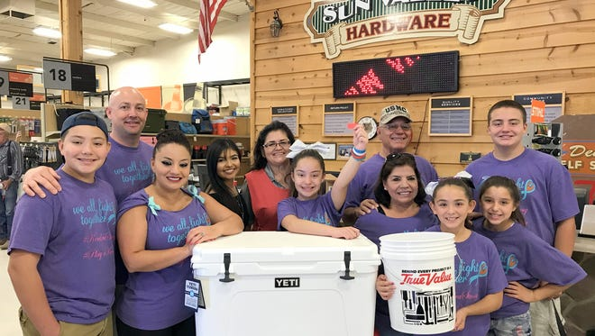 The Kendra Strong Team was on hand for a raffle drawing at Sun Valley True Value Hardware Store in Deming. Kendra Hensley (center with arm raised) drew the winning ticket for Ryan Smrkovsky of San Angelo, TX. Smrkovsky won the Yeti 65-quart cooler valued at $499. Pictured from left are twin brother Ezra Hensley, Kevin Hensley, Ofelia Hensley, Xenya Rockwell, Sylvia Rodriguez, Kendra, Francisco Hensley, grandmother Ofelia Hensley, Helena Herrera, Kelsie Westbrook and Brenden Hensley.