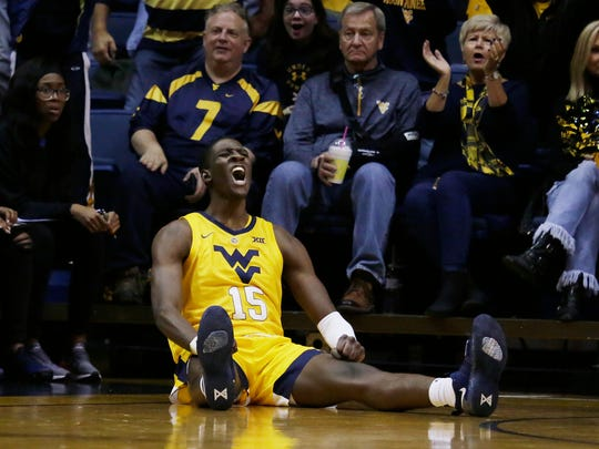 West Virginia forward Lamont West (15) screams after making a 3-point basket and being fouled during the first half of an NCAA college basketball game against Buffalo, Friday, Nov. 9, 2018, in Morgantown, W.Va. (AP Photo/Raymond Thompson)