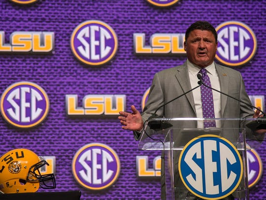 LSU Tigers head coach Ed Orgeron talks to the media