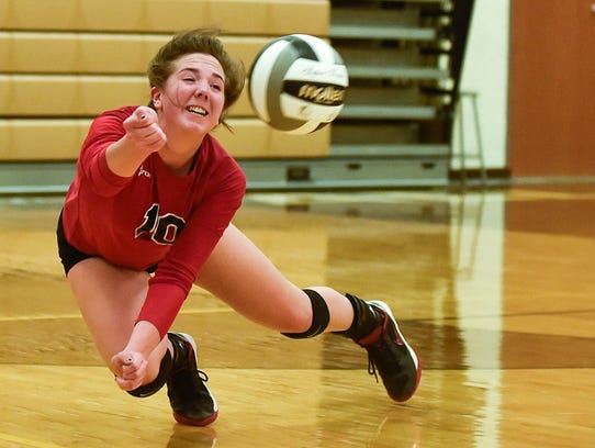 Pleasant's Emilee Riley dives for the ball during the
