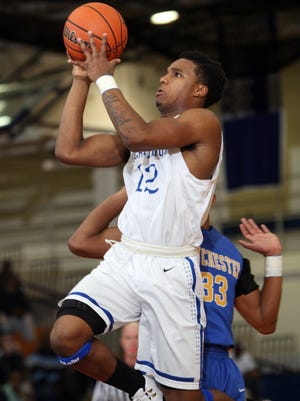 Amir Tyler, #12 Lakewood, shoots as his team plays Manchester in a boys basketball game Tuesday, January 20, 2015, at Lakewood High School. Jody Somers / For The Asbury Park Press