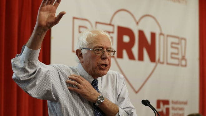 Democratic presidential candidate Sen. Bernie Sanders, I-Vt., gestures while speaking to nurses during a visit to the National Nurses United office Monday, Aug. 10, 2015, in Oakland, Calif.