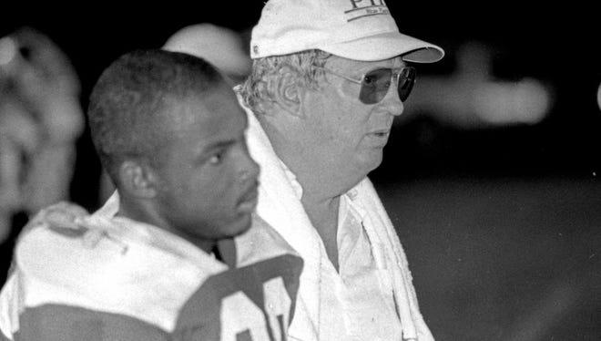 Pickens head coach Bill Isaacs coaches against Seneca in 1989.