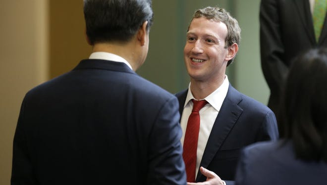 Mark Zuckerberg is holding a town hall with Indian Prime Minister Narendra Modi on Sunday. Here he is seen meeting Chinese President Xi Jinping during a gathering of CEOs and other executives at Microsoft's Remond, Wash., campus earlier this week.