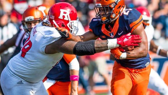 Illinois running back Ra'Von Bonner (21) is tackled