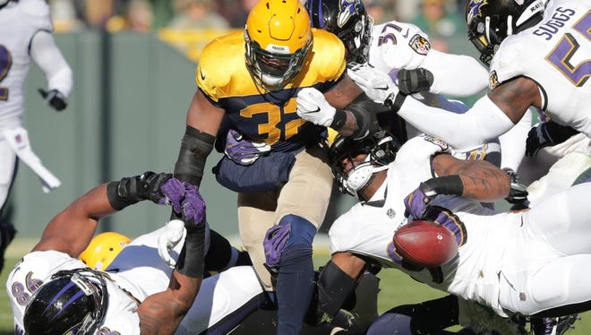 Green Bay Packers running back Devante Mays fumbles in the first half against the Baltimore Ravens on Sunday, November 19, 2017, at Lambeau Field in Green Bay, Wis.