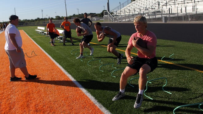 """Solon running backs practice Aug. 3. """"We have a lot of guys that have experience so that is going to help,"""" senior quarterback Brandan Childs said."""