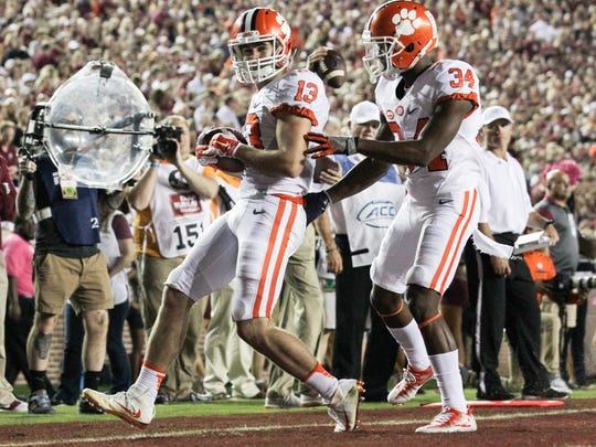 Clemson wide receiver Hunter Renfrow (13), left, scores the second touchdown of the game near teammate receiver Ray-Ray McCloud (34) during the first quarter on Saturday October 29 at Doak Campbell Stadium in Tallahassee, Florida.