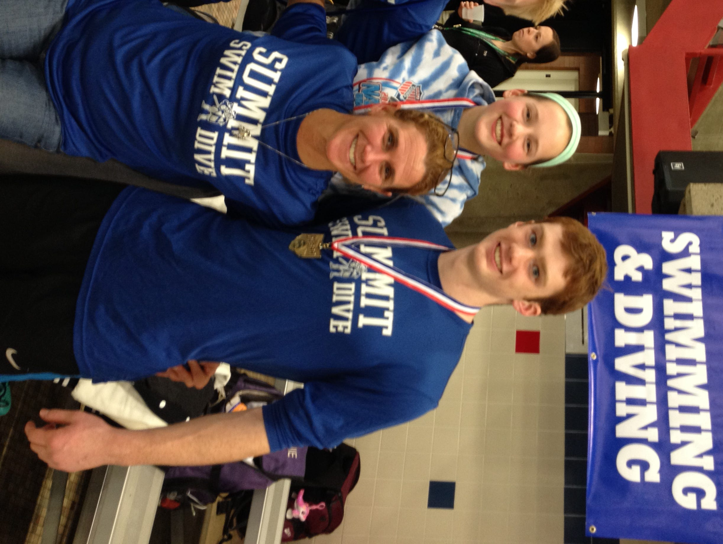 Summit Country Day's state divers included, from left: Mitch Reinhard, Emma Hellmann and state champ Stewart Spanbauer, with their coach Lori Rapp in front.