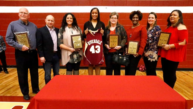 Former players and a coach was inducted into the Riverdale Girls Basketball Hall of Fame on Tuesday. Pictured (L to R) are inductee Scott Pryor (assistant coach), Michael Burt (presenter), inductee Melissa Weiland, Krystle Horton, whose jersey was retired, inductee Lisa Harrison, inductee Valerie Malone, former coach Hillary Hodges (presenter), and Felicia Nelson (mother of inductee Shacobia Barbee).