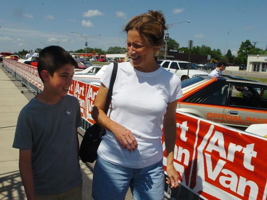 Noah Wagner,12 and his grandma Iris Barbu walked down to Art Van and checked out the Penske cars.