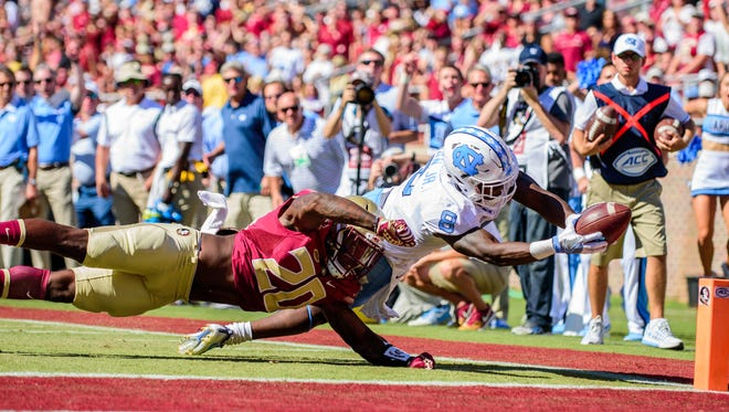 Trey Marshall (20) dives in attempt to stop a touchdown during the 37-35 FSU loss against UNC.