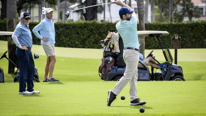 Corey Brown tees off during the member and guest golf tournament at the Breakers Ocean Course on Saturday.