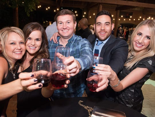 Cheers during the Phoenix Uncorked Wine Festival in