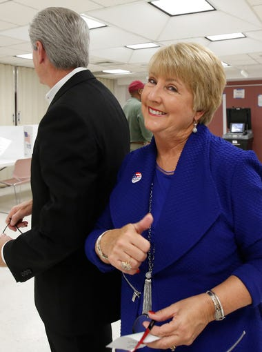 Mississippi first lady Deborah Bryant gives a thumbs up sign as she and her husband, Gov. Phil Bryant leave their Jackson, Miss., precinct Tuesday, Nov. 3, 2015, after voting. Mississippi voters are deciding whether to elect Gov. Bryant to a second term and their attorney general to a fourth. They also are filling all 174 legislative seats and choosing between two school funding initiatives.