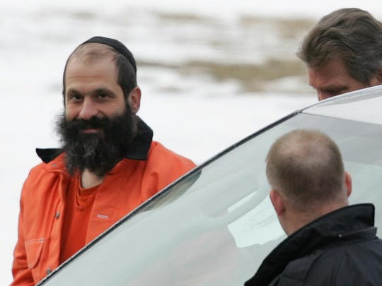 Federal agents escort Sholom Rubashkin, former head