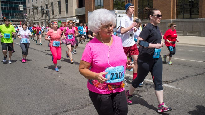 People of all ages participate in the 2015 Komen Race for the Cure,  April 26, 2015.