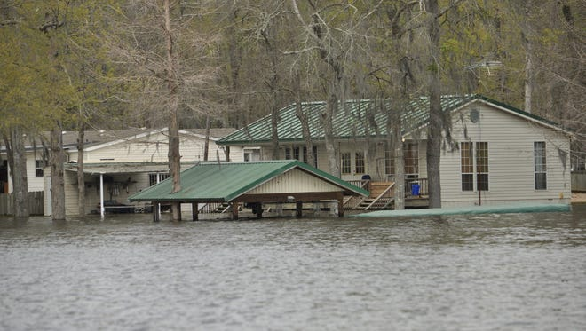 This residence in the Nantachie Lake area of Grant Parish was among those affected by spring flooding this year. Although Central Louisiana is no stranger to flooding, relatively few homeowners have flood insurance.