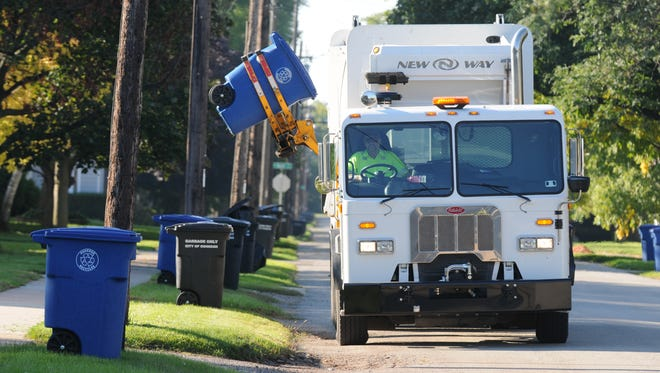 Neenah will switch to automated trucks for the curbside collection of garbage and recyclables. The carts, though, won't be blue.
