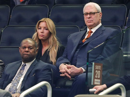 Los Angeles Lakers owner Jeanie Buss, left, sits next