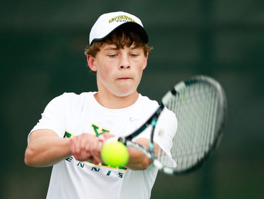 St. Xavier's Drew Singerman played McCracken County's Tommy Hagan during the team titlle of the 2014 Boys KHSAA Tennis Tournament at the UK Boone/Downing Tennis Complex on the campus of the University of Kentucky, Thursday, May 15, 2014. Photo by Jonathan Palmer, Special to the CJ