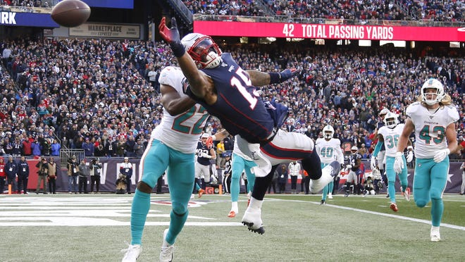 New England Patriots wide receiver N'Keal Harry (15) can't come up with this pass in the end zone behind Miami Dolphins defensive back Tae Hayes (22) during the first half at Gillette Stadium on Dec. 29, 2019.