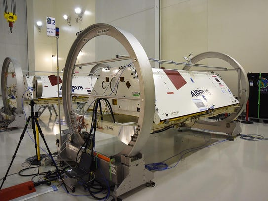 GRACE-FO satellites in a clean room. The Gravity Recovery