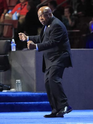 U.S. Representative from Georgia John Lewis dances onto the stage on the third day of the Democratic National Convention.
