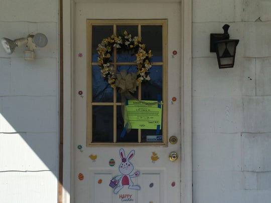The door of a house where a man was found dead has