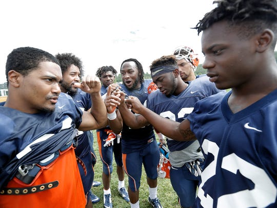 The UTEP running backs break huddle to end Thursday's morning practice at Camp Ruidoso.