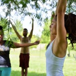Kaila Varano, right, the IDEAS for UCF event organizer, leads students in a yoga session on Sunday, June 5, 2016, at Jay Blanchard Park. IDEAS, which stands for Intellectual Decisions on Environmental Awareness Solutions, works little by little to make a positive impact on the community through different events such as yoga days and park clean-ups.