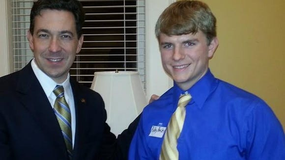 Kolby Busby, the executive director of the Mississippi Federation of College Republicans, is shown with GOP U.S. Senate primary candidate Chris McDaniel.