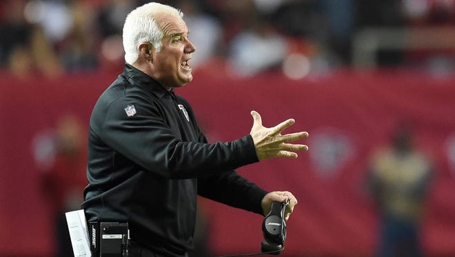 Dec 28, 2014; Atlanta, GA, USA; Atlanta Falcons head coach Mike Smith reacts to the play against the Carolina Panthers during the second half against the Atlanta Falcons at the Georgia Dome. The Panthers defeated the Falcons 34-3.