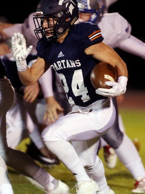 Payton Craig of Summit runs the ball during their game against Page at Summit High School Friday November 10, 2017.