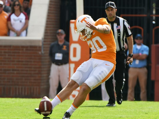 Tennessee place kicker Brent Cimaglia (30) kicks the