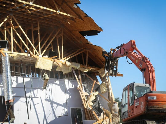 Workers demolish the Victory Christian Center building in San Angelo on Thursday, June 21, 2018. A large section of the roof collapsed May 25.