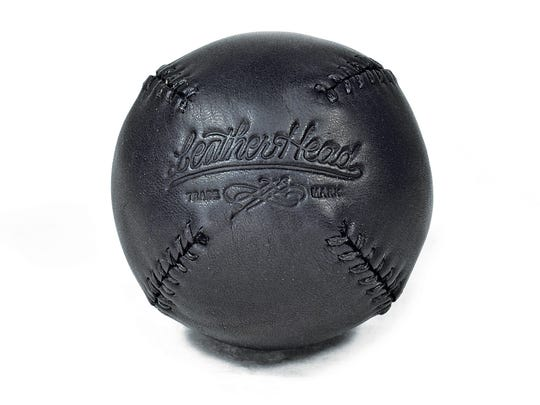 This Lemon Ball, made from genuine black onyx leather, is inspired by the original lemon peel-style baseball used in the 1800s.
