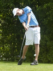 South Burlington's Devon Havers hits his drive on the
