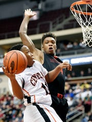 Central York's Onterio Edmonds shoots against Reading's Lonnie Walker in the second half of the PIAA District 3 Class AAAA boys basketball championship game Saturday, Feb. 27, 2016, at the Giant Center in Hershey. Central York, playing its first district title game since 1984, lost 65-54 to Reading.