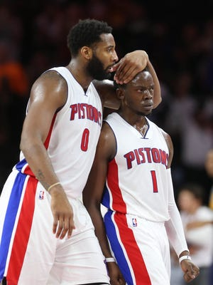 Pistons center Andre Drummond, left, and guard Reggie Jackson celebrate after a basket against the Cavaliers during the fourth quarter of the Pistons' 106-101 win March 9, 2017 at the Palace.