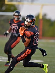 Northeastern's Taemar Willis carries the ball against
