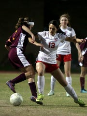 Palm Desert's Lindsay Forester battles for the ball during the Aztecs' playoff win over Barstow in Palm Desert on Thursday, February 15, 2018.