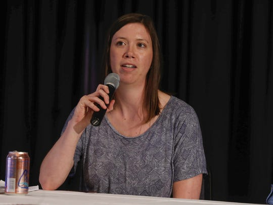 Ellen Walsh-Rosmann, who operates an organic farm near Harlan, speaks on a panel addressing the changing face of agriculture on Thursday, Sept. 14, 2017, at the Clay County Fair in Spencer. The event was part of the Register's Changing Iowa project.