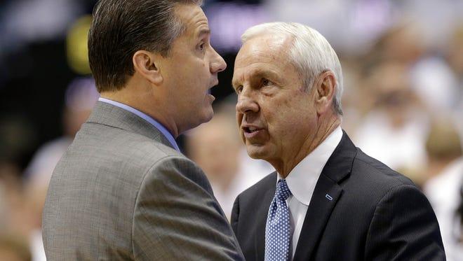 Kentucky coach John Calipari, left, and North Carolina coach Roy Williams speak before an NCAA college basketball game in Chapel Hill, N.C., Saturday, Dec. 14, 2013. (AP Photo/Gerry Broome)