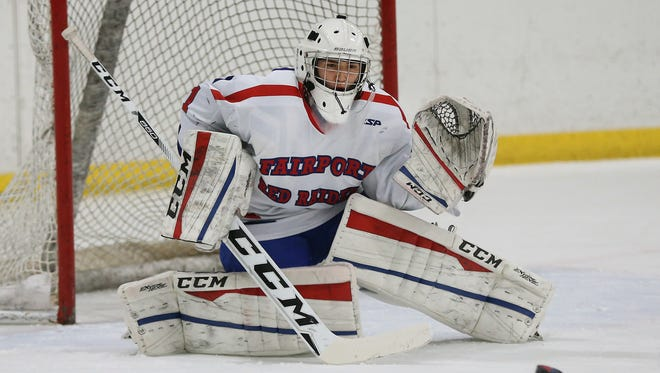 Fairport goalie Michael Layer made 22 saves in the Red Raiders' 2-1 victory over McQuaid in the Class A semifinals.