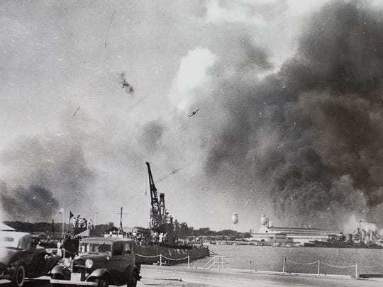 Planes fly over Pearl Harbor.