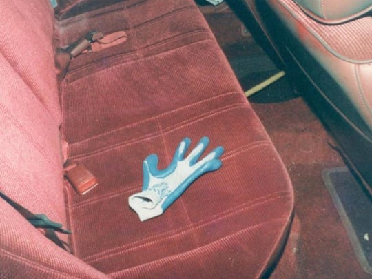 Police found a blue and gray Kevlar glove on the backseat