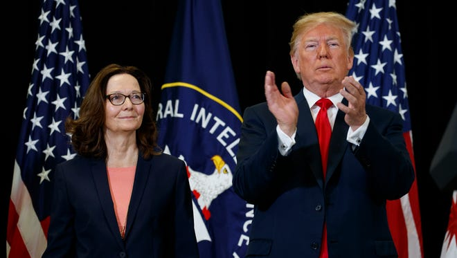 President Trump applauds incoming Central Intelligence Agency director Gina Haspel during a swearing-in ceremony at CIA Headquarters Monday in Langley, Va.