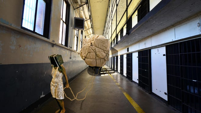 """Elena Lourenco's """"Bound"""" has been exhibited three times before arriving at the Old Montana State Prison, a place she says is the first to support the piece's emotional qualities and provide a dynamic space that lends movement to the piece."""